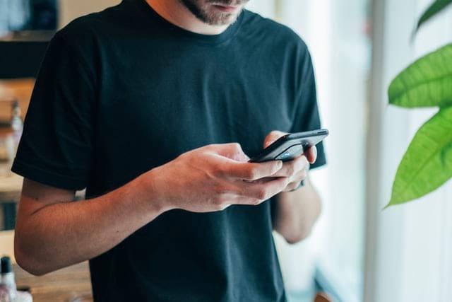 Sagittarius Man Glued To His Phone