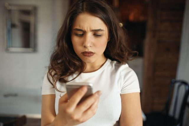 Woman Waiting For A Text From Sagittarius Ex